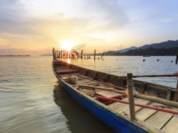 half-fisherman-boat-with-beautiful-sunset-at-black-sand-beach-langkawi